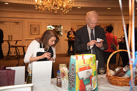 Perusing the Silent Action Items at the Partners for Women and Justice's Annual Celebrate Hope Spring Benefit, 2019.