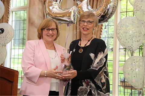 VP of Community Relations Jeanne Braham (l) presents the Distinquished Service Award to DiAnne Arbour (JBWS Executive Director from 1980- 1997).